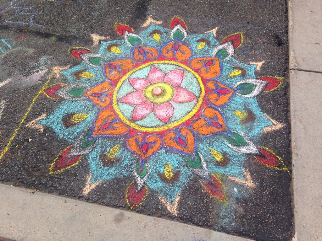 chalkfest reston chalk art drawing of flower design with candle in middle