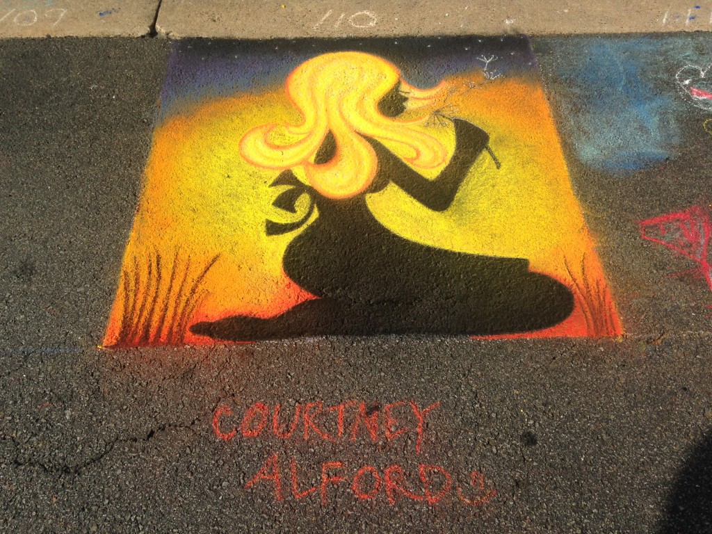 chalkfest reston chalk art drawing of silhouette of girl blowing dandelion