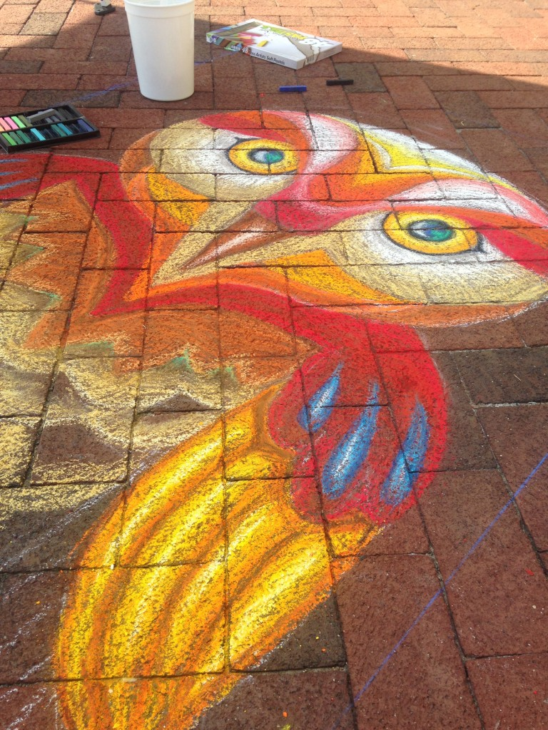 chalkfest reston chalk art drawing of colorful owl in progress