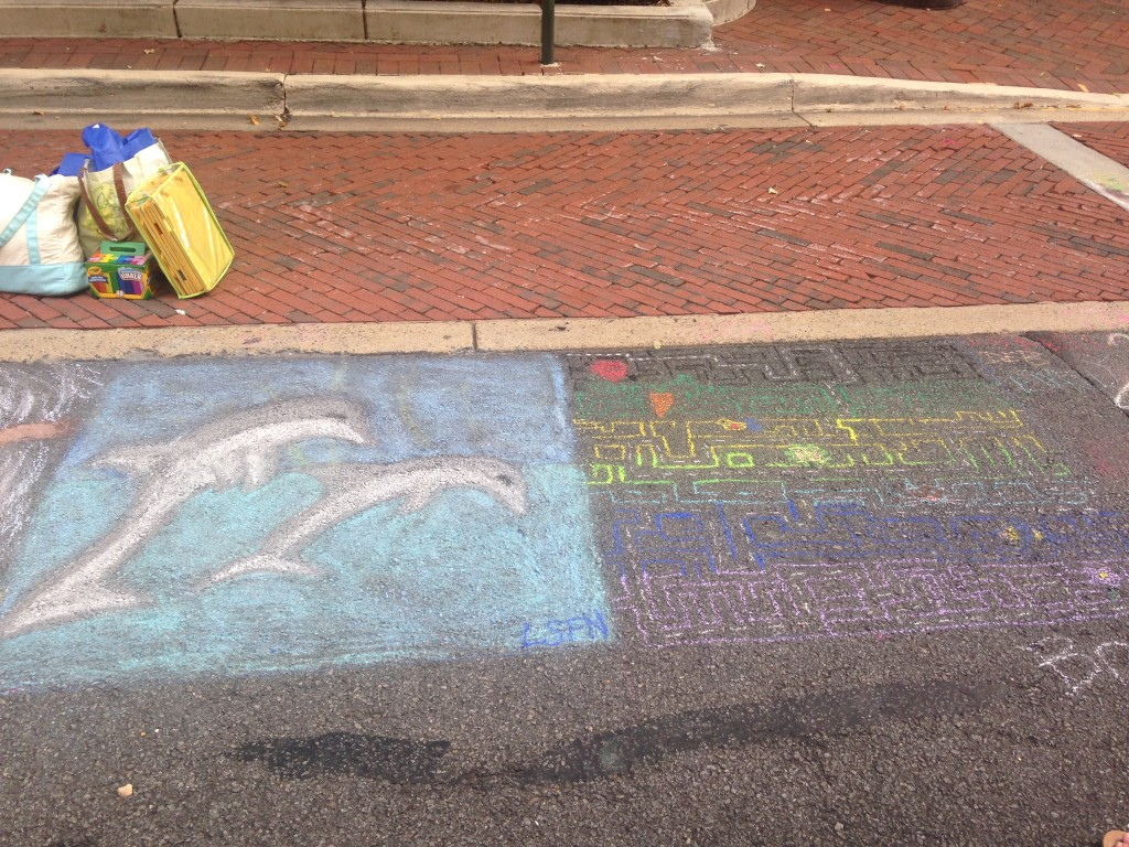 chalkfest reston chalk art drawing of dolphins and maze