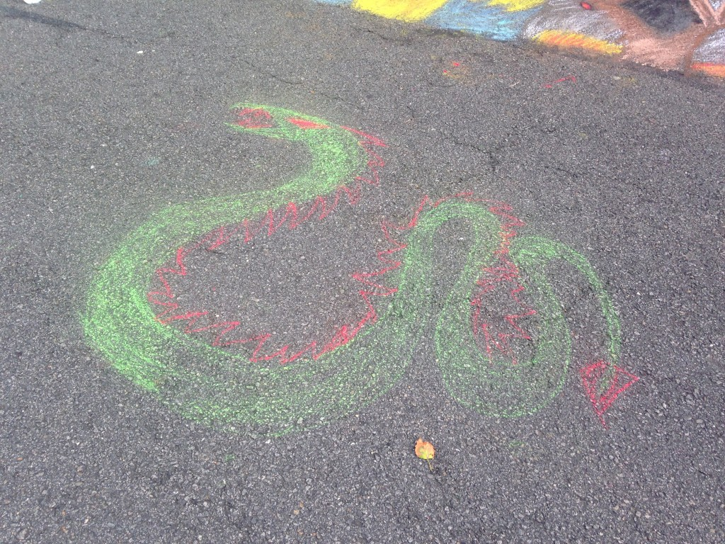 chalkfest reston chalk art drawing of green and red snake or dragon