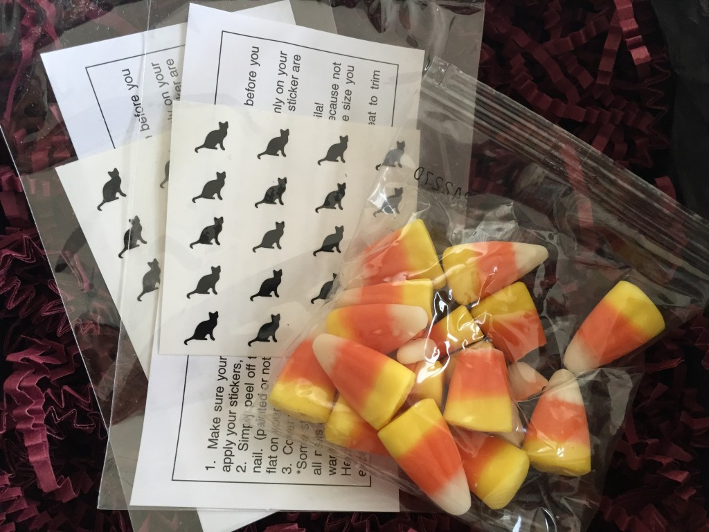 julep black cat nail decals and bag of candy corn