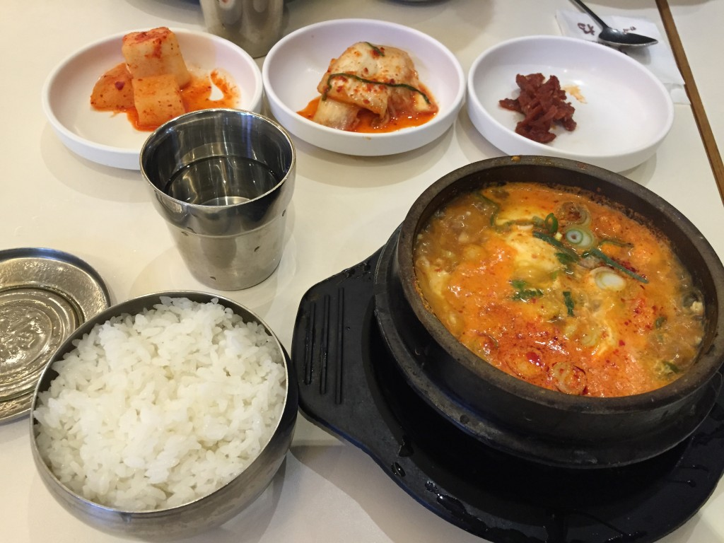 korean tofu soup and sides for breakfast at seoul station