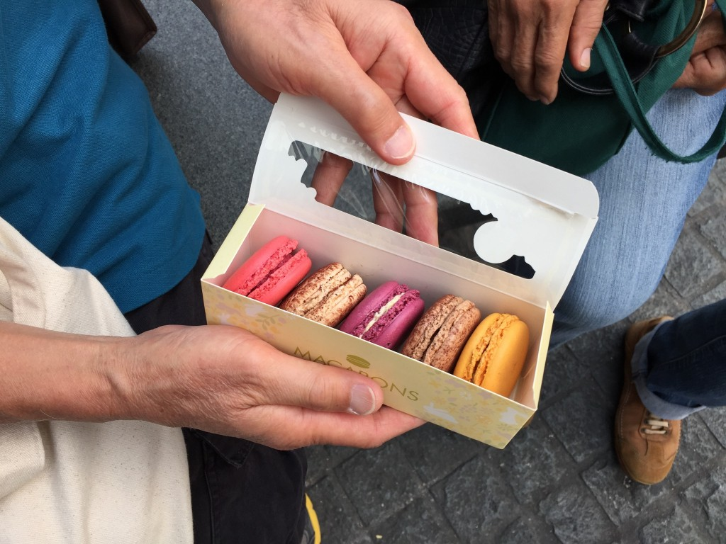 boxed set of mcdonald's macarons in five flavors: raspberry, chocolate, passionfruit, coffee, and mango