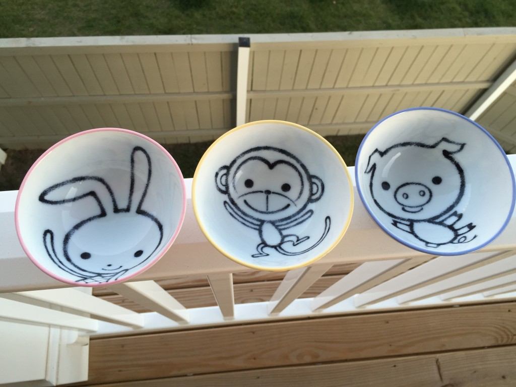 set of three mini bowls with a pink bunny, yellow monkey, and blue pig designs