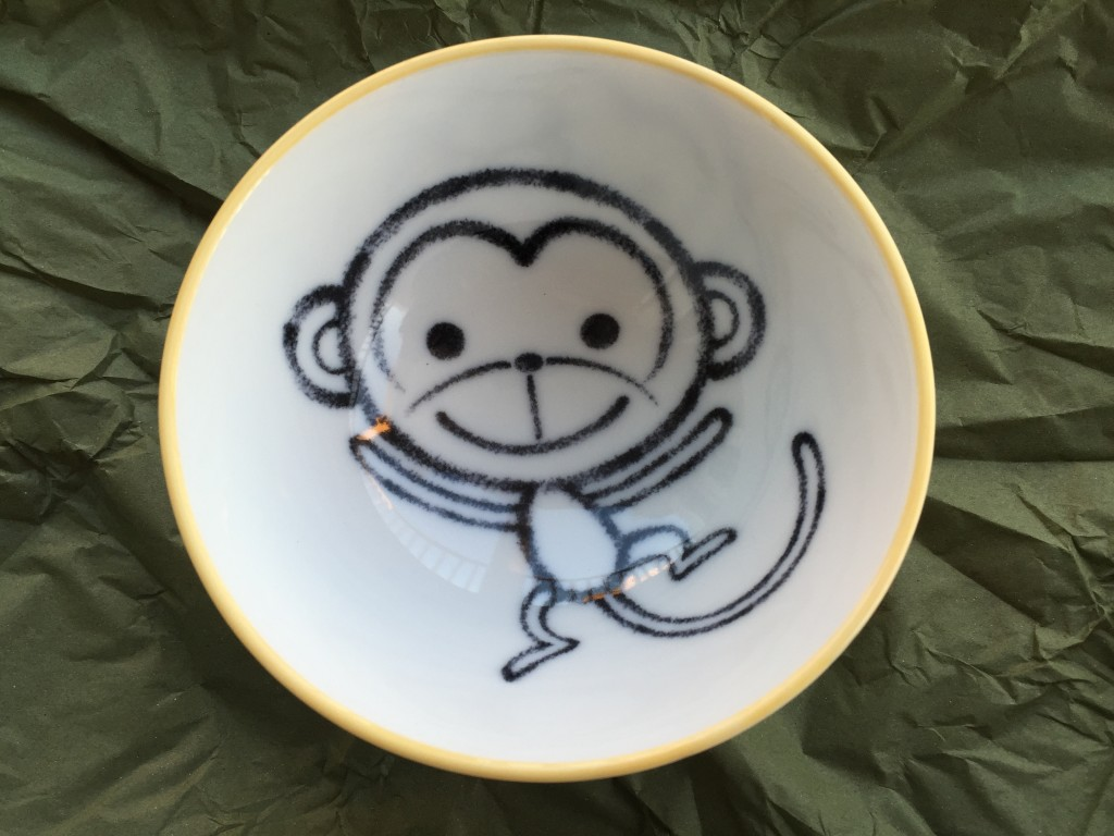small bowl with cartoon monkey design inside