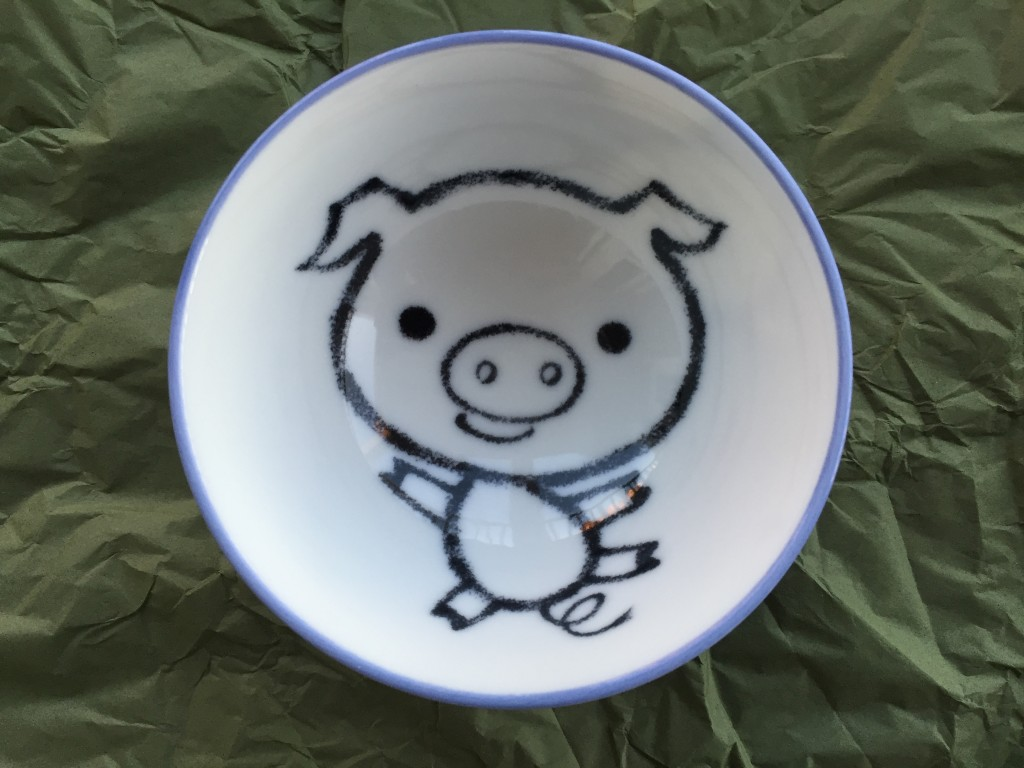 small bowl with cartoon pig design inside