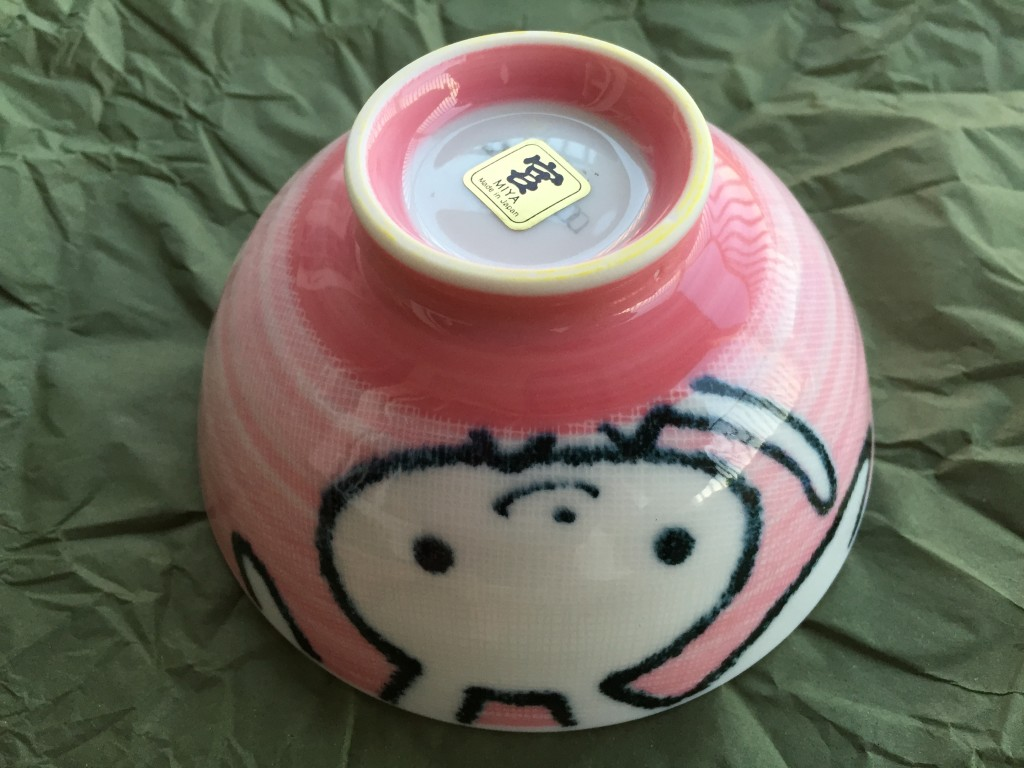 small pink bowl with cartoon bunny design on side