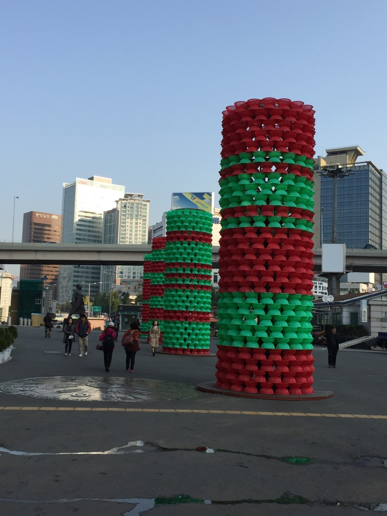 plastic columns of red and green baskets outside of seoul station