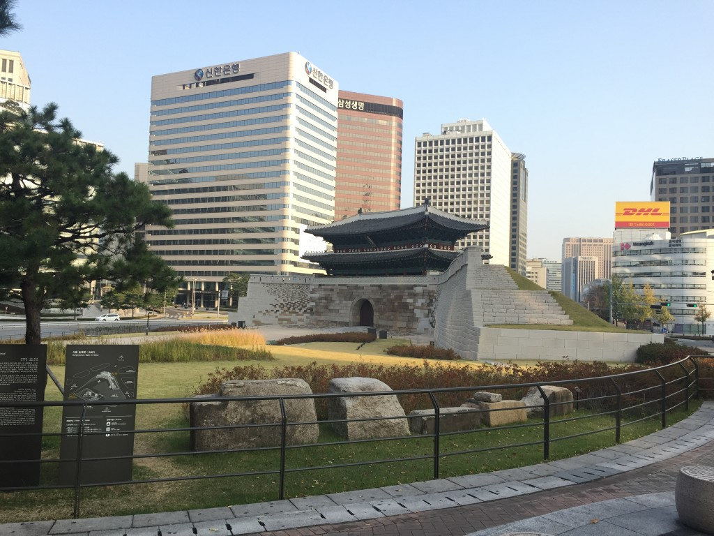 sungnyemun gate and surrounding area with large buildings in background