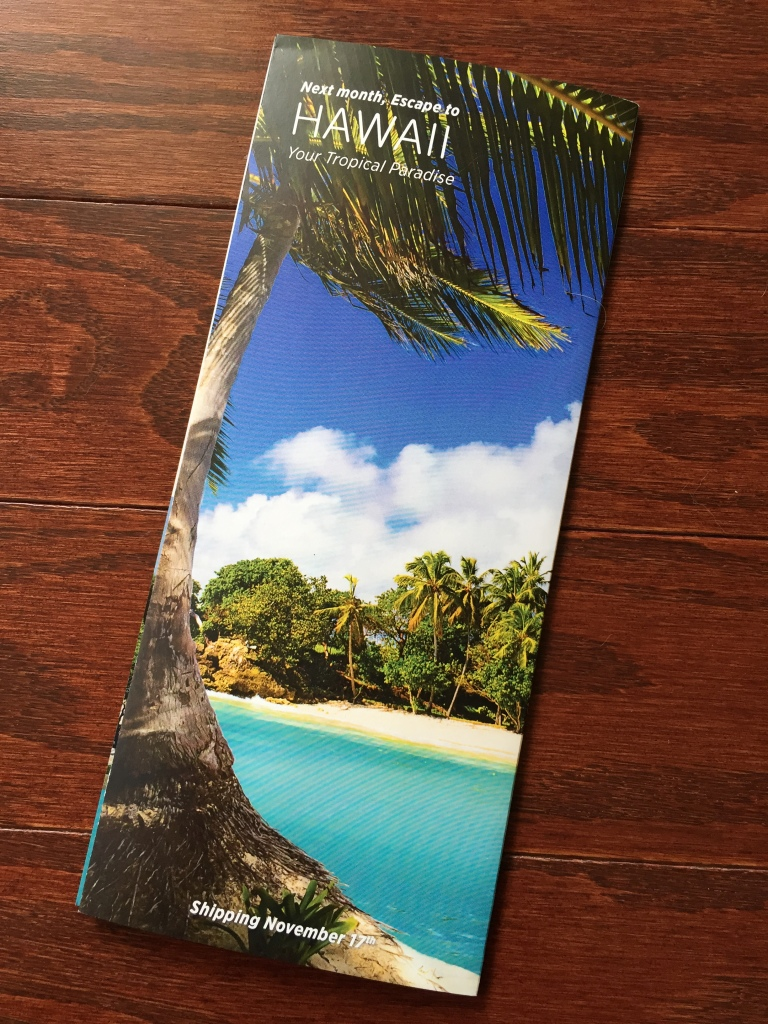 escape monthly october london box info card back with preview of next month's box theme of hawaii