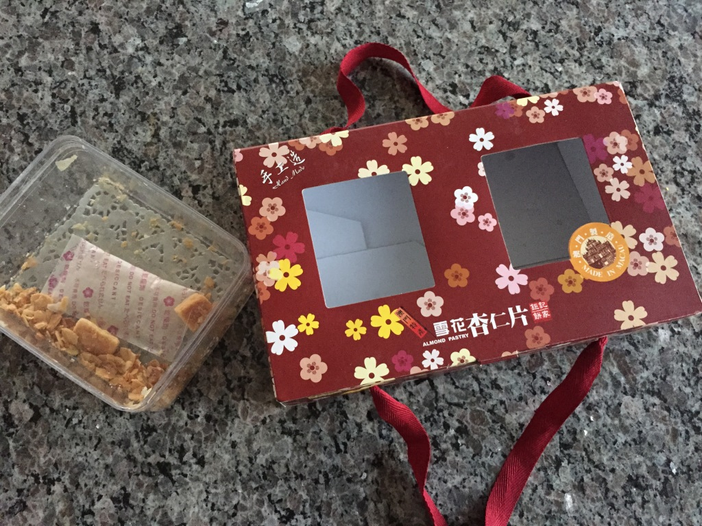 empty box of flaky almond pastry treats from macau