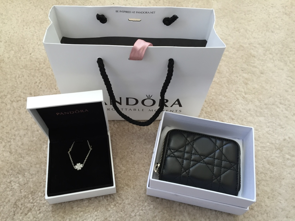 pandora bracelet and christian dior coin purse with pandora bag