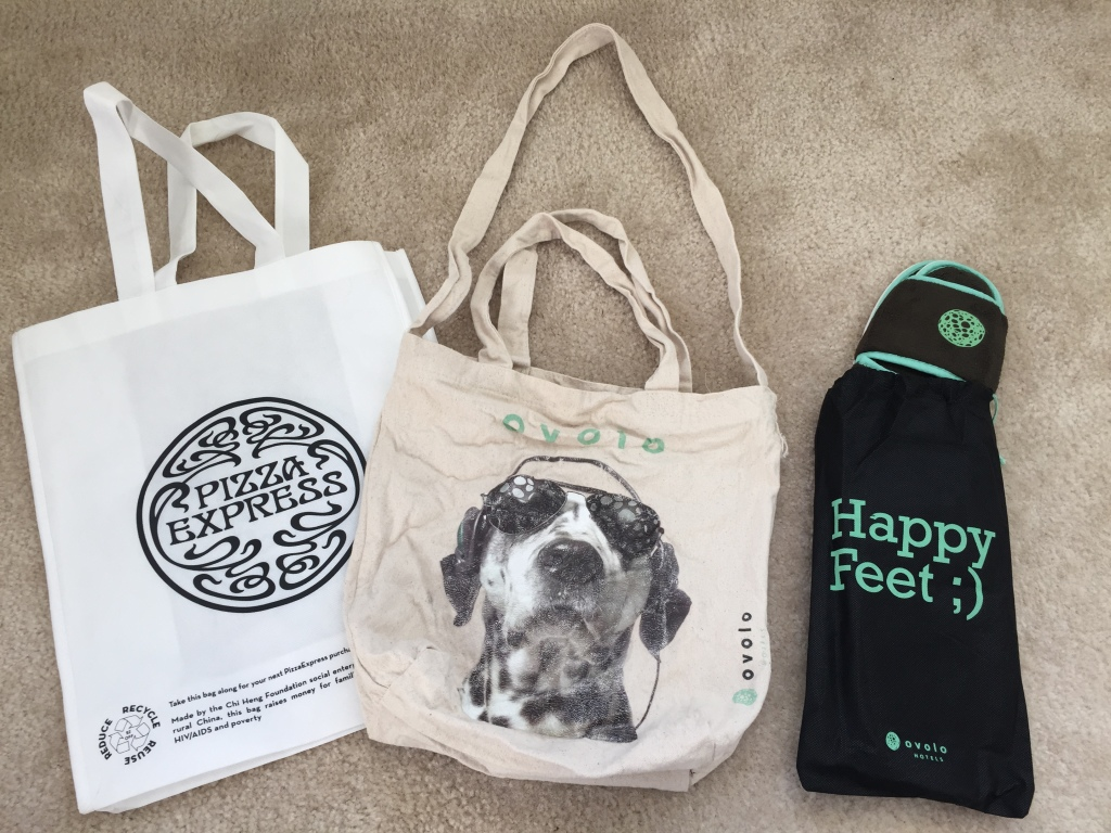 pizza express bag, ovolo hotels go bag, and drawstring bag with slippers inside