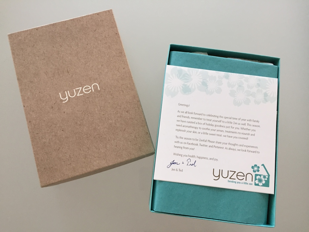 yuzen november-january 2014 winter box open with brown lid, card with welcome message, and teal tissue paper