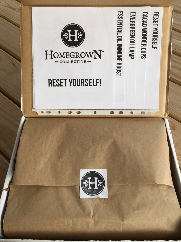 inside of reset yourself homegrown collective box with the info sheets on the inner lid