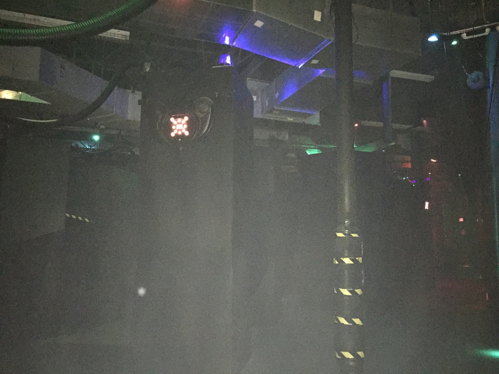 laser tag arena with everything painted black and glowing lights everywhere