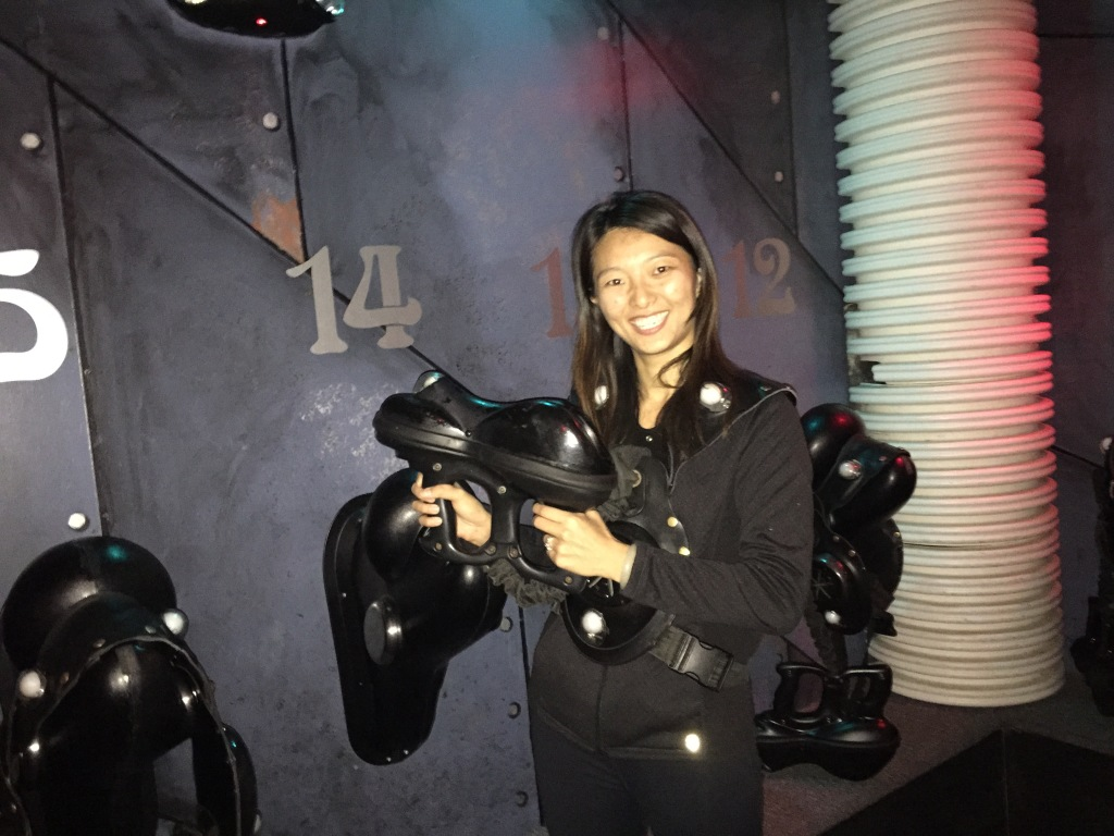 girl wearing laser tag pack for laser tag game