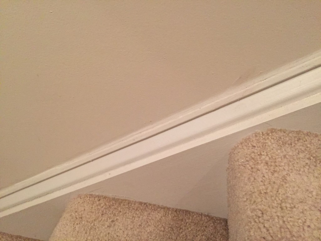 crack by stairs of home concealed after caulking job