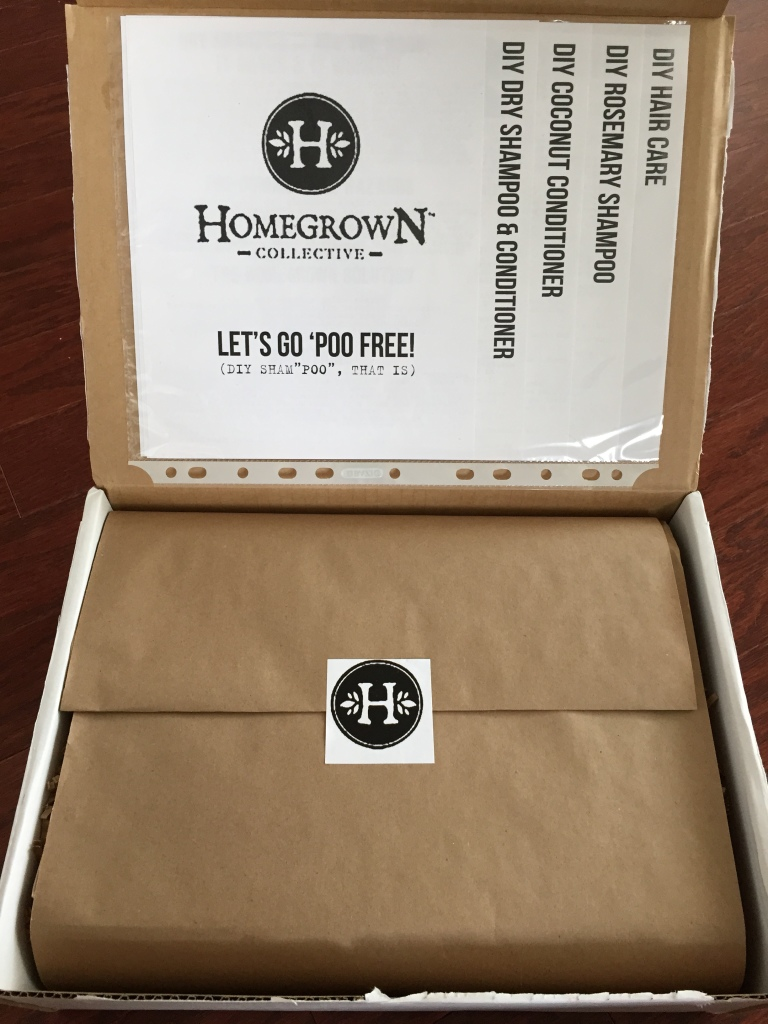 inside of let's go 'poo free homegrown collective box with the info sheets on the inner lid