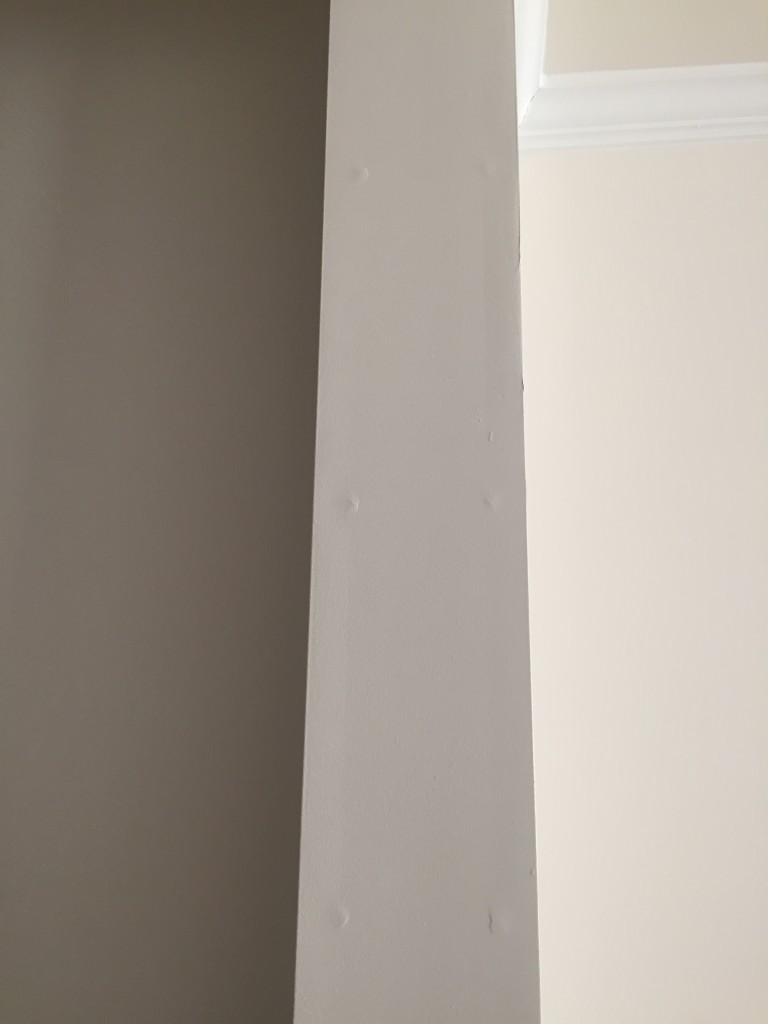 set of nails popping underneath drywall causing bumps