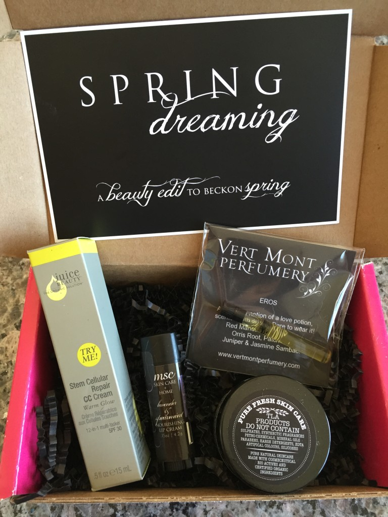 contents of petit vour march 2015 box with juice beauty cc cream, msc nourishing lip cream, vert mont perfumery fragrance, the little alchemist face glow, and info card with spring dreaming theme