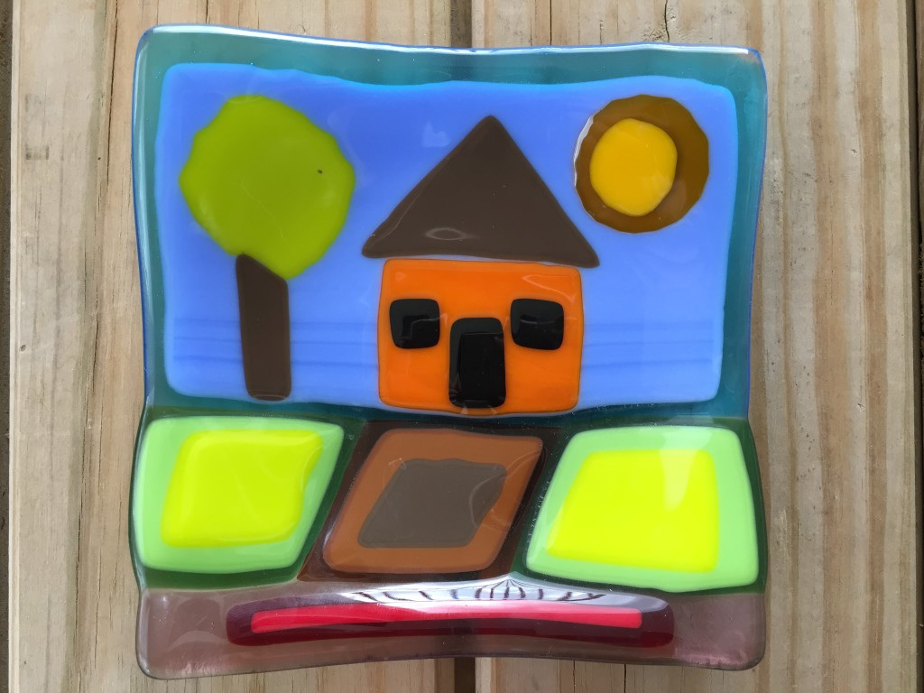 fused glass piece of house, tree, sun, driveway, and yard