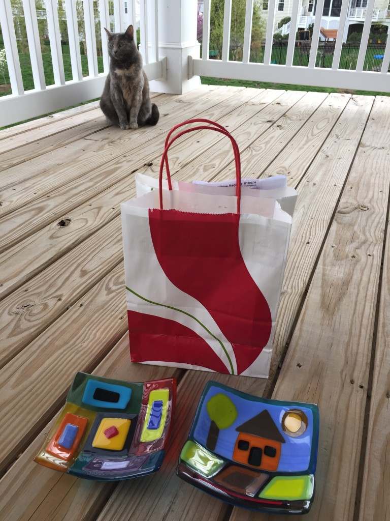 completed fused glass projects with gift bag and cat in background