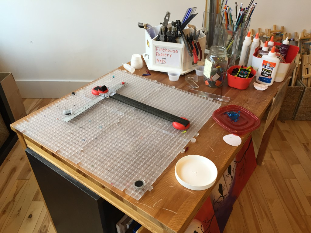 glass scoring station at firehouse pottery and arts