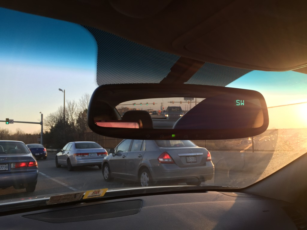 view of giant beach ball in rearview mirror of car