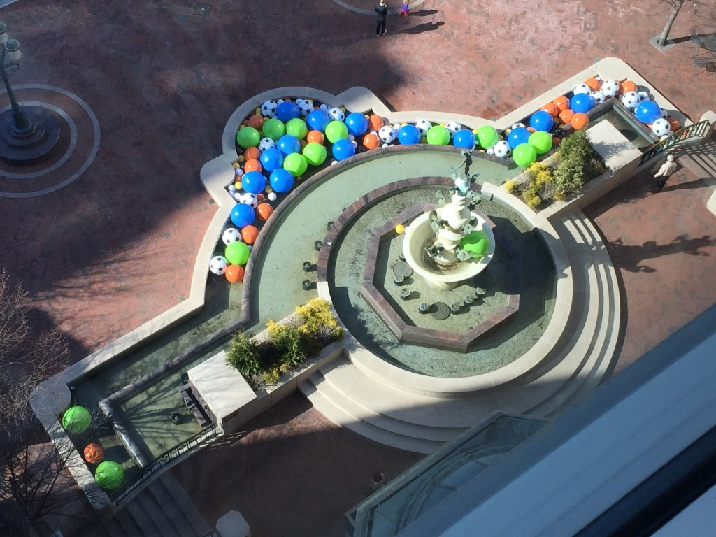 reston town center fountain filled with large plastic beach balls for april fool's