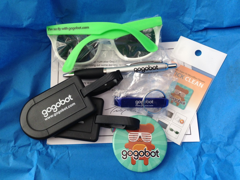 gogobot pro 2014 sunglasses, pen, luggage tags, bottle opener, screen wipe sticker, and pin
