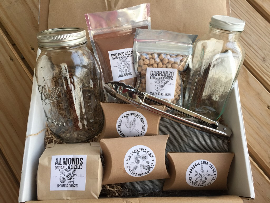 contents of the homegrown collective march 2015 box with let's get sprouted theme