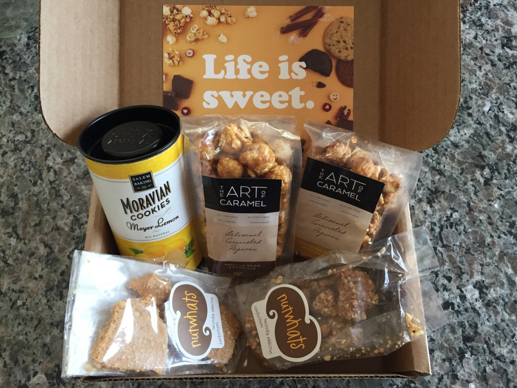 treatsie june 2015 box contents with salem baking moravian cookies, the art of caramel artisanal caramelized popcorn, and nutwhats confection crunch