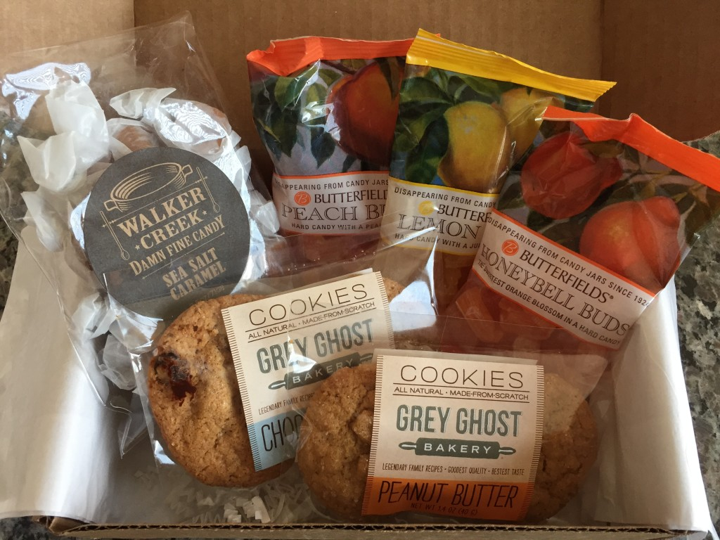 treatsie august 2015 box contents with walker creek caramels, butterfields candy buds, and grey ghost bakery cookies