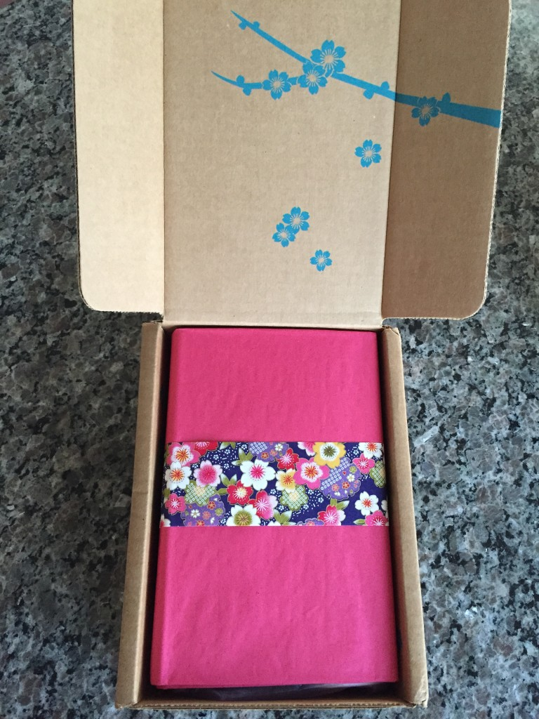 yuzen august-october 2015 autumn box open with fuchsia tissue paper and piece of yuzen paper