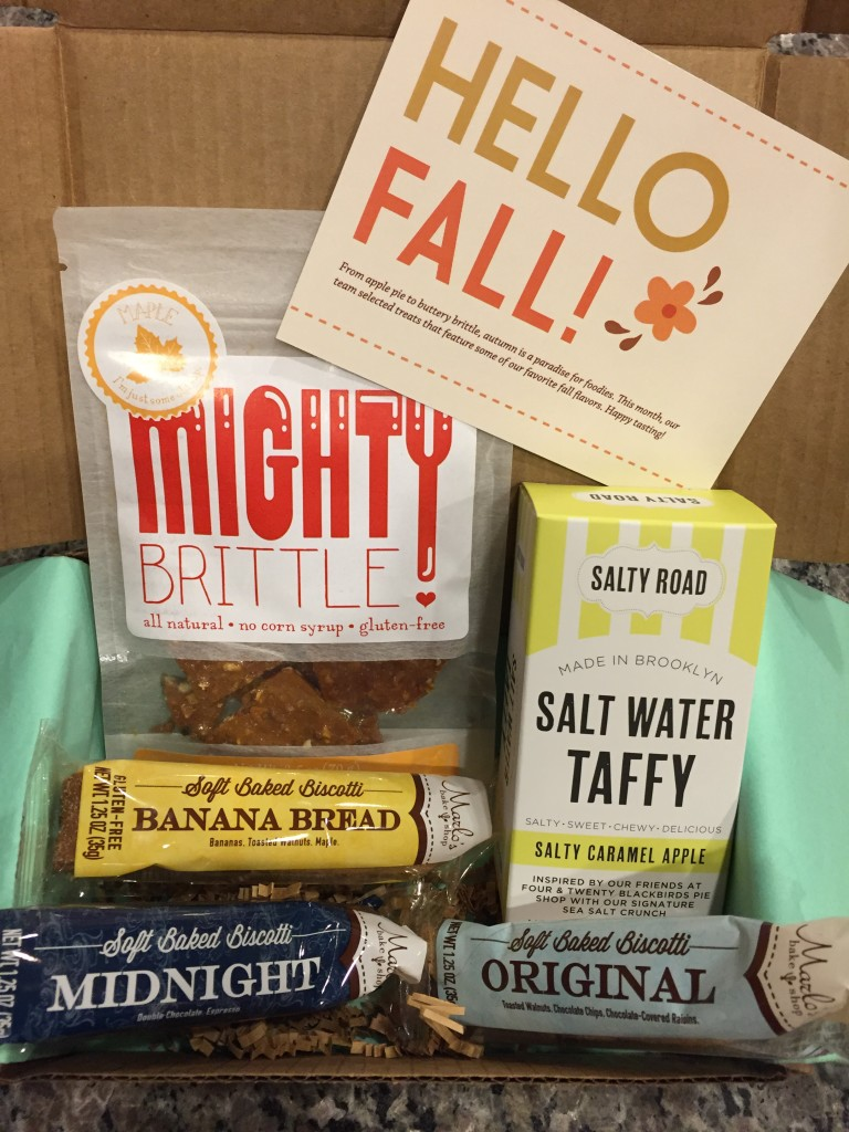 treatsie september 2015 box contents with mighty brittle, salty road taffy, and marlo's bake shop biscotti