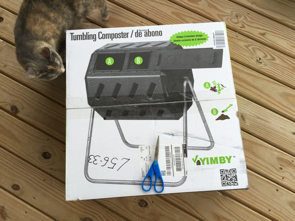 tumbling composter box with cat sniffing corner