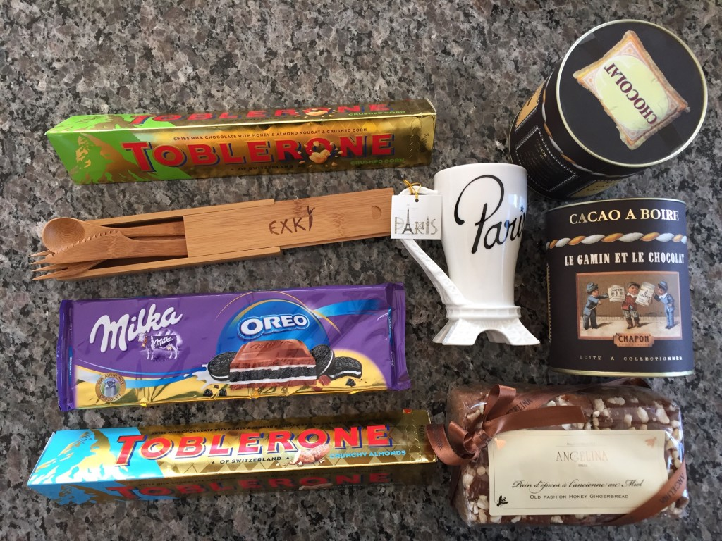 chocolate bars, bamboo utensils, mug, hot chocolate powder, and gingerbread from france