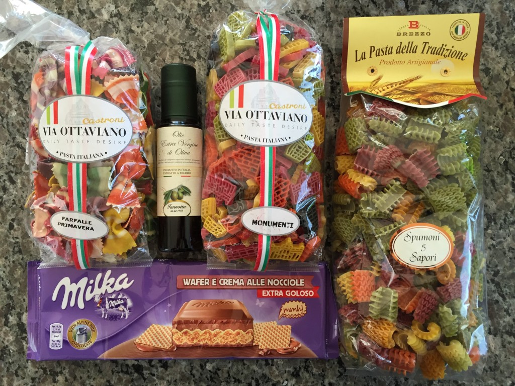 bags of pasta, bottle of olive oil, and bar of chocolate from italy