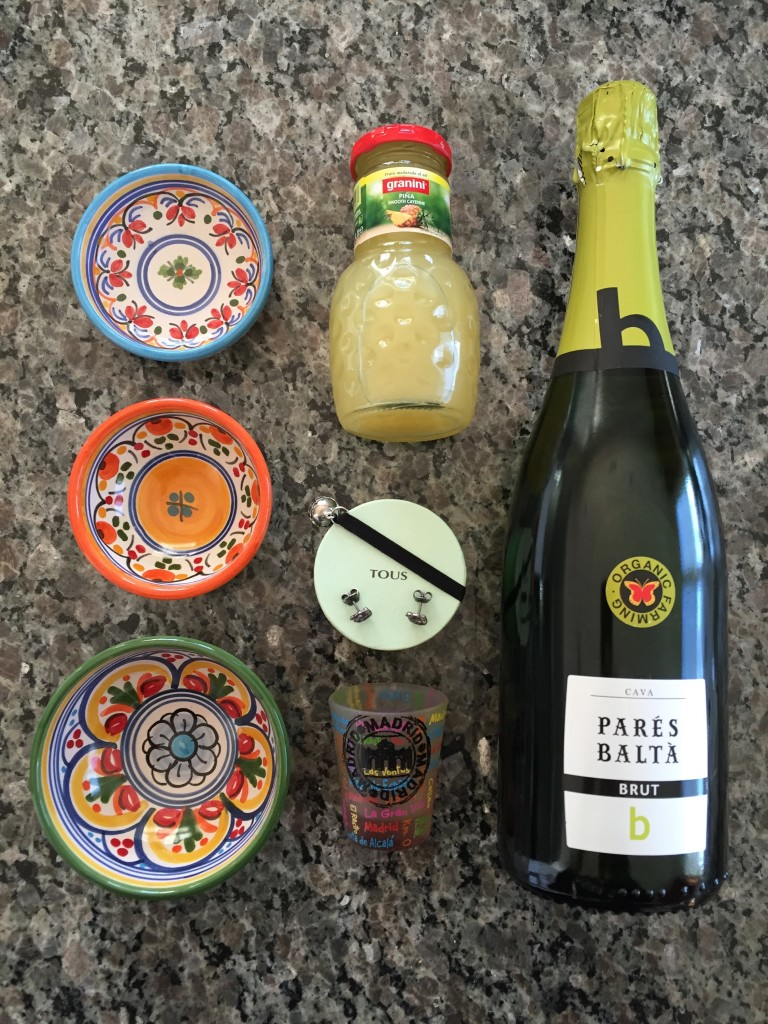 sauce bowls, tous earrings, shot glass, and drinks from spain