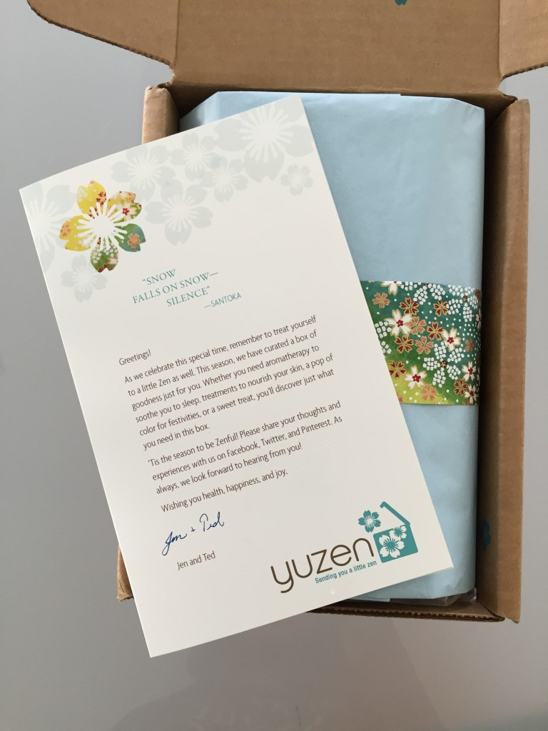 yuzen november-january 2015 winter box open with pale blue tissue paper, piece of yuzen paper and info card