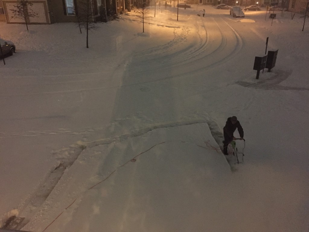 man pushing snowblower outside on driveway during blizzard 2016