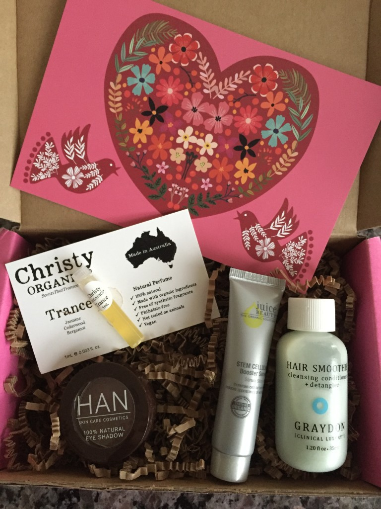contents of petit vour february 2016 box with oh, it is love! theme and info card