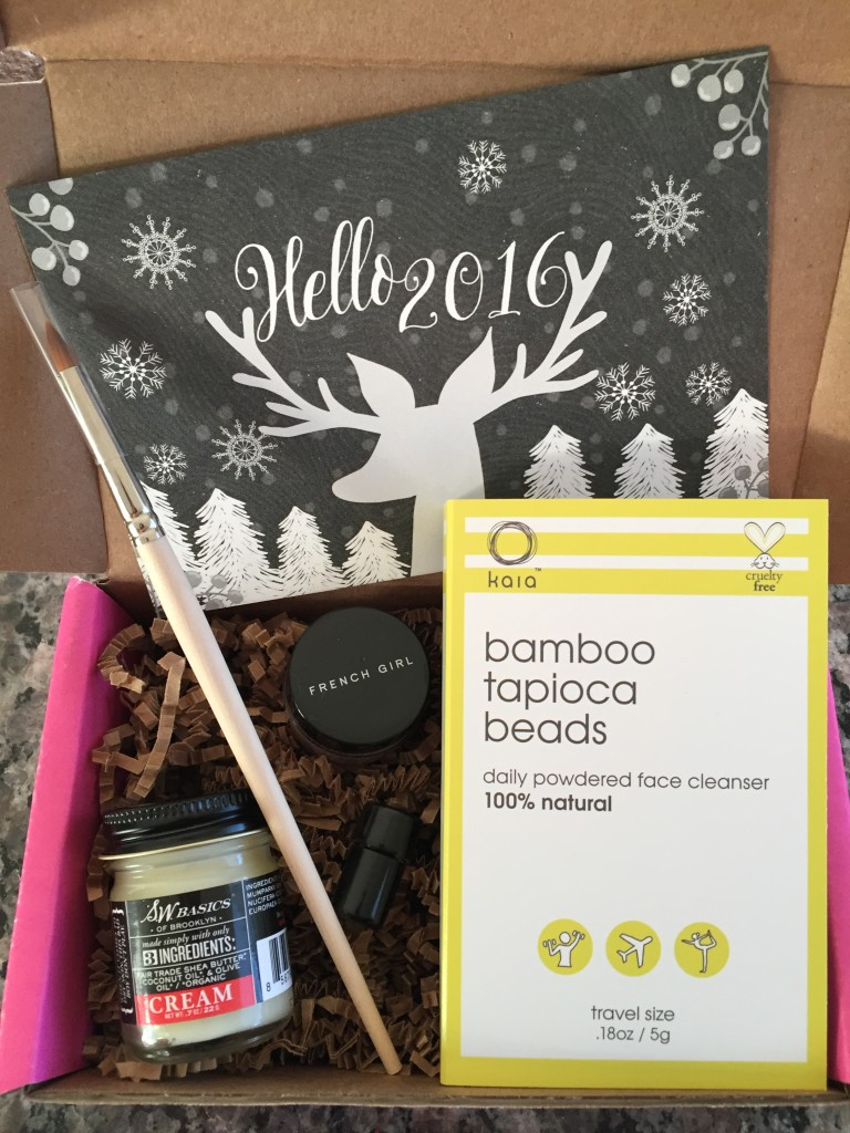 contents of petit vour january 2016 box with hello 2016 theme and info card