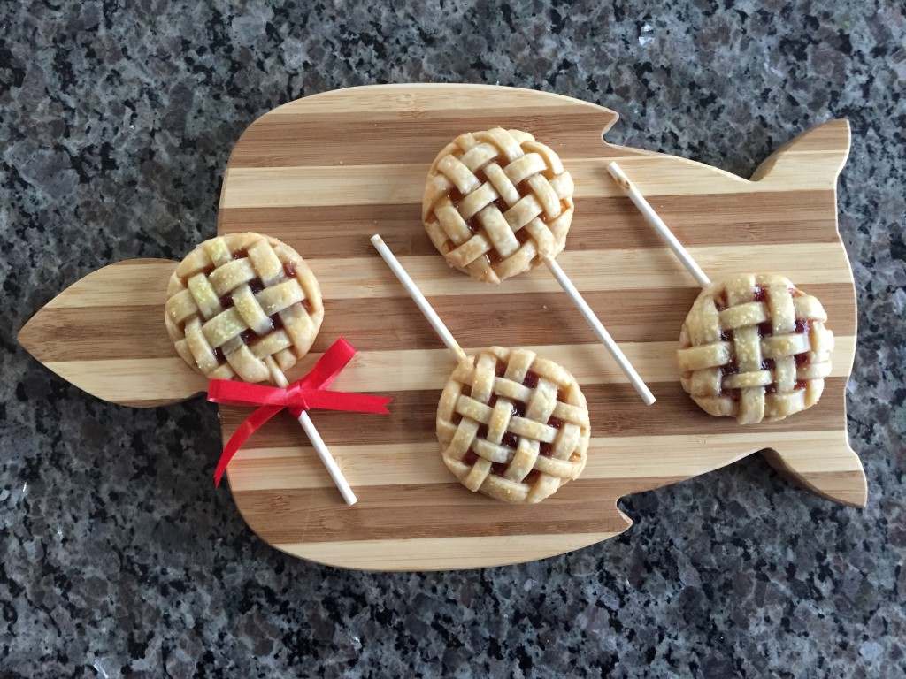 finished pie pops laid out on turtle-shaped cutting board