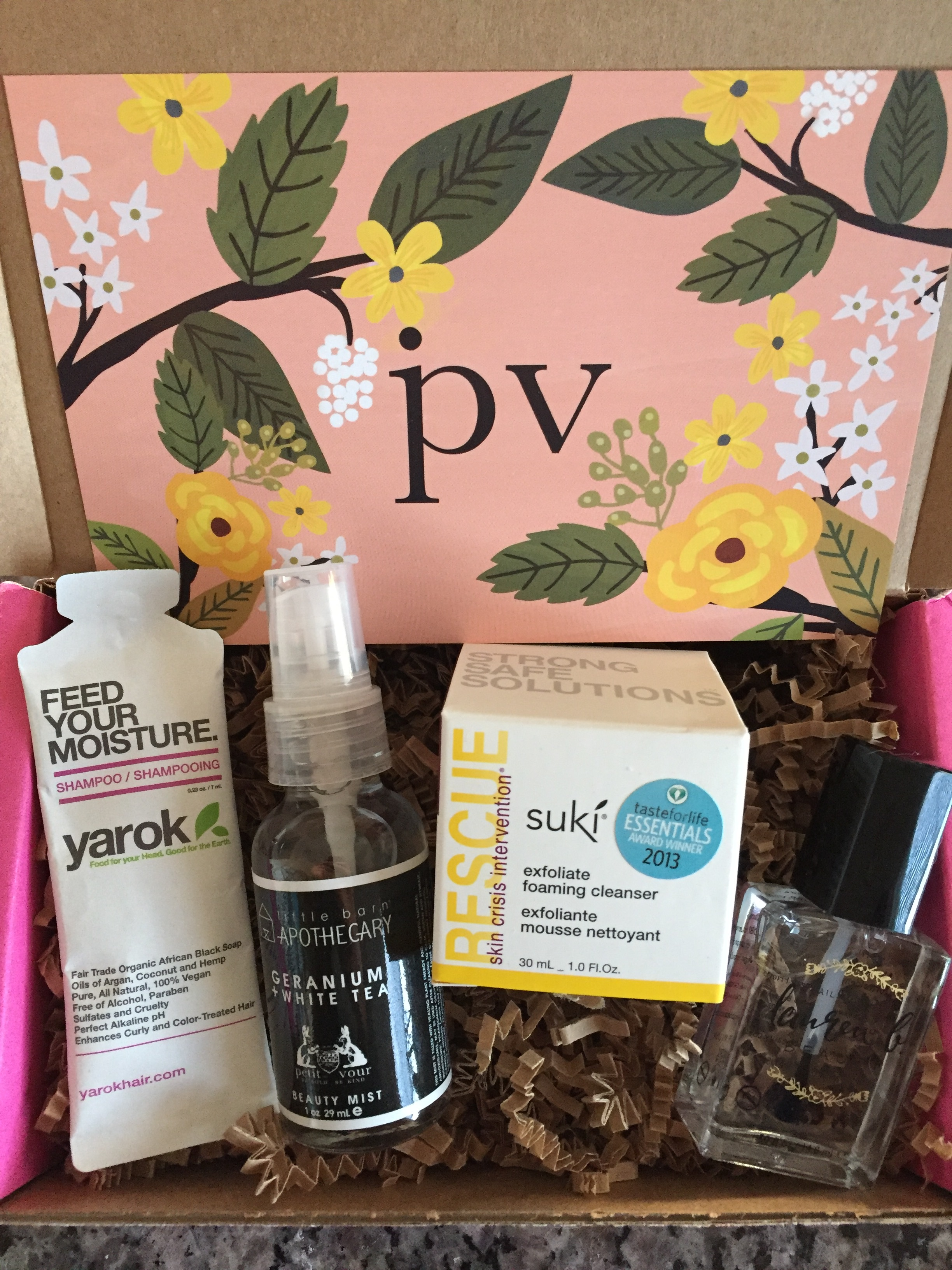 contents of petit vour march 2016 box with fresh start theme and info card