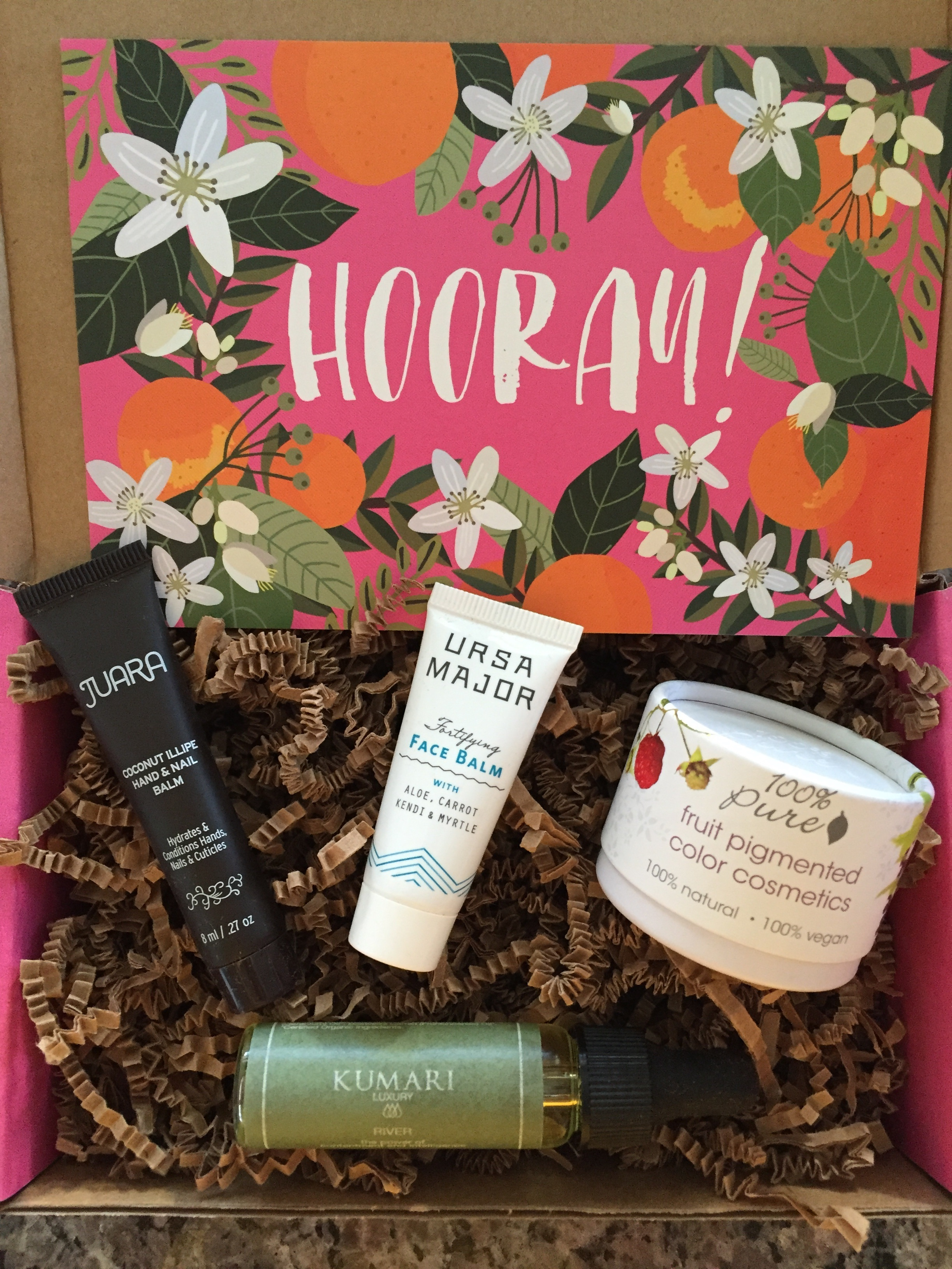 contents of petit vour april 2016 box with hooray! theme and info card