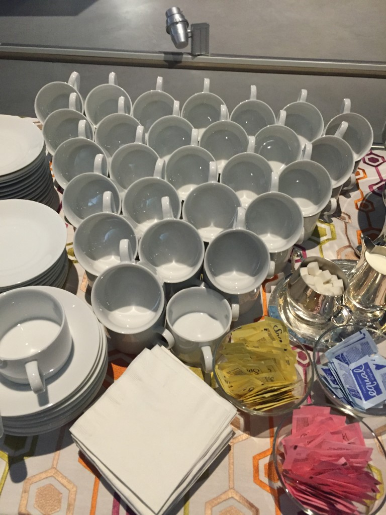 nasm volunteer appreciation night drinks table with mugs stacked neatly in pyramid shape