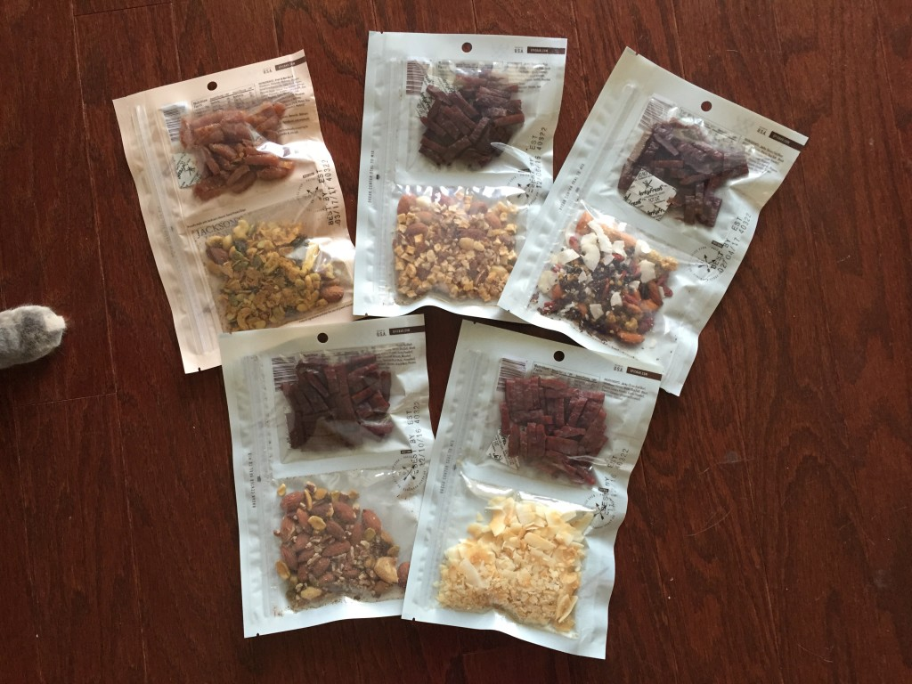 five assorted bags of epic jerky and trail mix